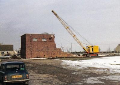 Demolishing the block houses